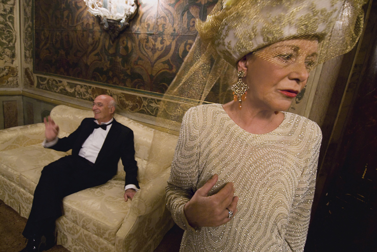 A couple at a party at the Casino of Venice.
