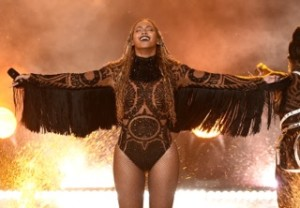 Beyonce wears bespoke Julien Macdonald  tribal bodysuit featuring Swarovs...