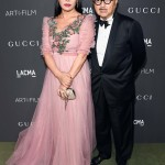 LOS ANGELES, CA - OCTOBER 29:  Host Eva Chow, wearing Gucci, (L) and actor Michael Chow attend the 2016 LACMA Art + Film Gala honoring Robert Irwin and Kathryn Bigelow presented by Gucci at LACMA on October 29, 2016 in Los Angeles, California.  (Photo by Frazer Harrison/Getty Images for LACMA)