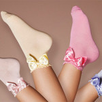 Story Loris - Calzine da bimba in diverse tonalità con fiocchetto alla caviglia
