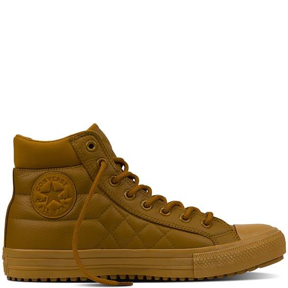 """Converse - Il modello """"Chuck Taylor All Star Boot PC"""" è la perfetta sneaker per l'inverno, realizzata interamente in pelle trapuntata color """"Antiqued""""."""