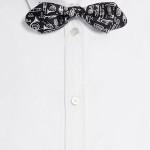 Papillon di Dolce&Gabbana in twill di seta con stampa di strumenti musicali