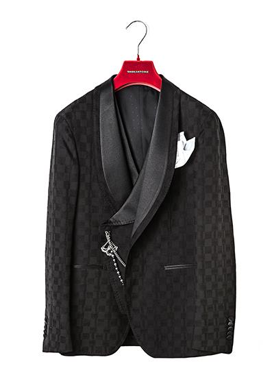 Tagliatore festeggia il Natale con una dinner jacket in limited edition. La giacca è sfoderata e destrutturata con fantasia damier irregolare in lana-cotone stretch.