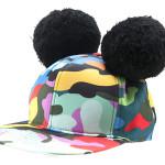 Made in Love: cappello snapback con ponpon e fantasia camouflage multicolor, regolabile sul retro, di M Collective.
