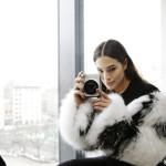 Ashley Graham wears the Silver MK X fUJIFILM INSTAX CAMERA
