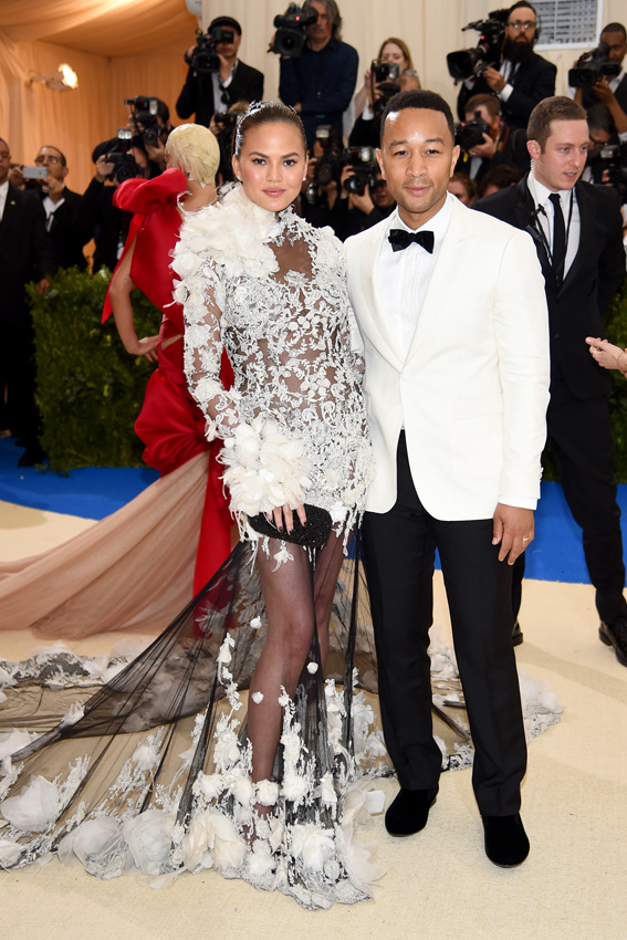 "NEW YORK, NY - MAY 01: Chrissy Teigen and John Legend attend the ""Rei Kawakubo/Comme des Garcons: Art Of The In-Between"" Costume Institute Gala at Metropolitan Museum of Art on May 1, 2017 in New York City. (Photo by Dimitrios Kambouris/Getty Images)"